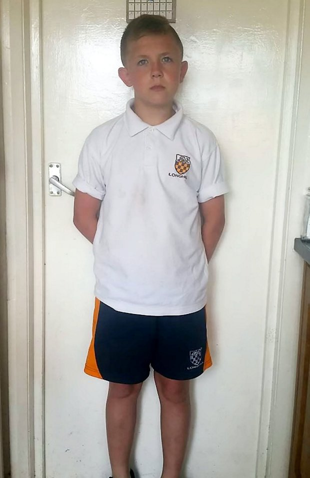 Michael Parker (14) of Longhill Hill High School Brighton, wearing his shorts.  Four teenage boys who were excluded for wearing shorts to school on the hottest day of the year have got around the stringent rules - by wearing SKIRTS.  See NATIONAL story NNSKIRT.  The Year 9 children put on their PE shorts on Tuesday, as they had done last summer, when temperatures hit 33C in a bid to cool down in the sweltering heat.  But in a change of policy, Longhill High School in Brighton, East Sussex, ordered the youngsters to go home and put on trousers and sent them in isolation.  Michael Parker, Kodi Ailing, George Boyland and Jesse Stringer, all 14, then decided to protest and wear skirts to school after finding a loophole in the code of conduct.